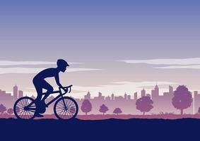 Silhouette of person riding a bicycle in a park vector
