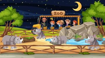 Safari at night scene with many kids watching rhinoceros group vector