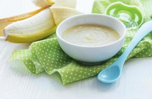 Bowl with fruit baby food and banana photo