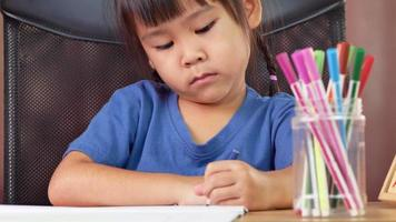 Little Girl Using Colored Pencils and Making Faces video