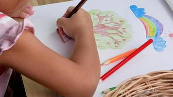 Little Girl Coloring a Tree and Rainbow video
