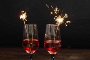 Sparklers inside of martini glasses photo