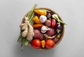 Top view basket with assortment of vegetables photo