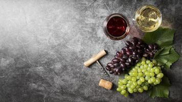 Top view delicious organic wine and grapes photo