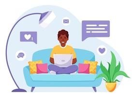 Afro american man sitting on a sofa and working on laptop. Freelancer, home office concept. Vector illustration