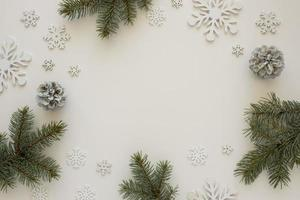 Top view natural pine needles with snowflakes photo