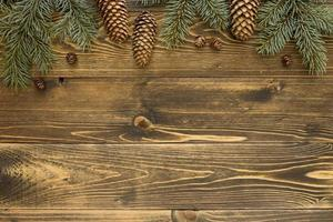 Top view natural pine needles on wooden board photo