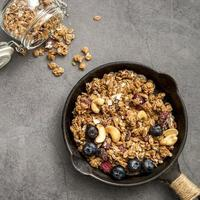 Top view pan with delicious homemade granola photo