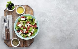 Top view salad with feta cheese cutting board with copy space photo