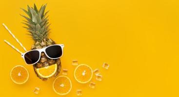 Top view summer fruit with copy space on yellow background photo