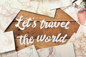 Top view travel concept with world maps photo