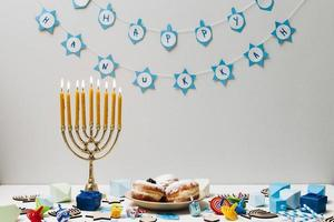 Traditional Jewish candle holder on table photo
