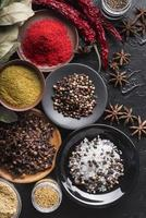 Various spices in bowls photo