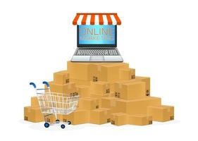 laptop online store with cardboard boxes and cart vector
