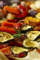 Baked vegetables on baking sheet photo