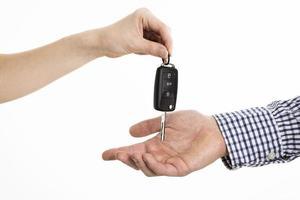 Hands exchanging car keys photo