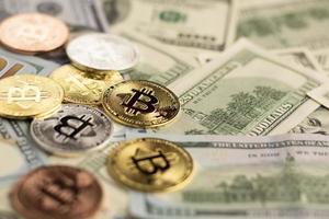 Bitcoin above dollar bills close-up photo