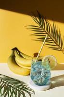 High angle drink and bananas arrangement photo
