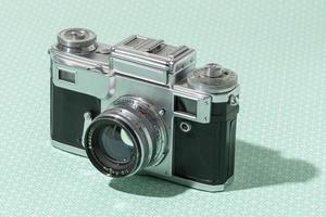 Vintage camera on blue background photo