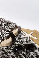 Sandals, sunglasses, and starfish photo