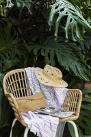 Chair with hat and beach towel photo
