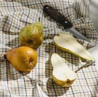 Halved pear on cloth photo