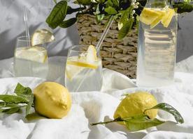 Lemon water on white bed sheet photo