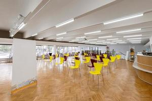Socially distanced chairs in a big room photo