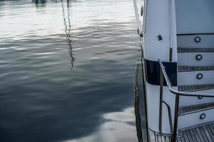 Details of the hull of a white yacht photo