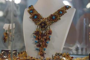 Beautiful amber jewelry on the shop window. photo