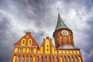 The sight of the city Cathedral on the background of cloudy sky photo