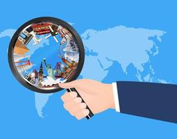 travel landmarks in magnifying glass on world map vector