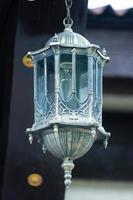 Vintage lamp on a dark background photo