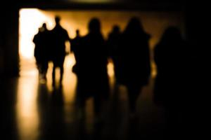 Blurry moving silhouettes in an underground passage. photo