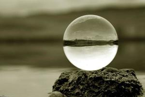 Landscape seen through the lens ball. photo