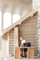 Miniature businesspeople working at home to protect themselves from coronavirus, work from home concept photo