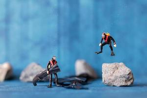 Miniature people, scuba divers clean up plastic rubbish pollution discarded in the ocean, underwater pollution concept photo