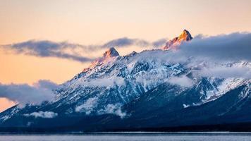 Snow-capped mountain range of Grand Teton at sunrise. photo