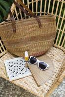 Beach accessories with crossword puzzle photo