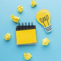 Innovation concept with lightbulb and crumpled paper photo