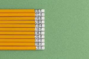 Pencils on green background photo