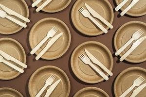 Flat lay of disposable plates and utensils photo