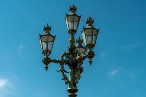 Lamp post against a blue summer sky photo