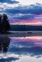 Early morning view cross a calm lake in Sweden photo