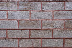 Old brick wall with red filling photo