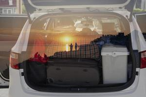 Double exposure of the car with things for traveling photo
