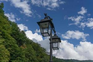 lights in antique style on the background of blue sky photo