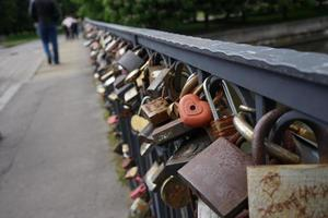 Locks on a bridge in Kaliningrad, the island of Kant photo