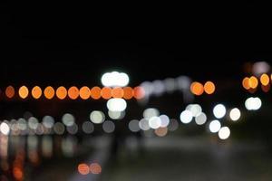 Fondo nocturno abstracto con bokeh brillante foto