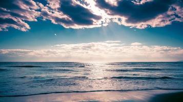 The sandy beach of the sea photo